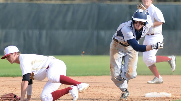 Roberson junior Garrett Blaylock, right, has committed to play college baseball for Vanderbilt.