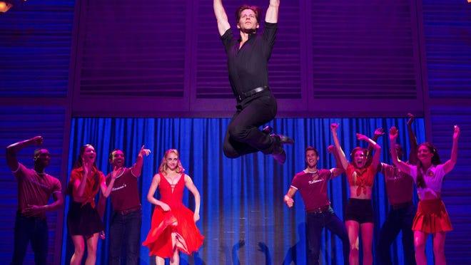 "Christopher Tierney as Johnny and the company of ""Dirty Dancing: The Classic Story on Stage."""