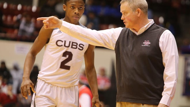 """We get a big lead, we relax,"" U-D Jesuit coach Pat Donnelly said of his team. ""I think we did that tonight. We have to get out of that habit."" Elijah Collins is No. 2."