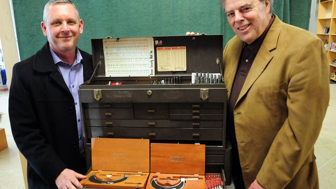 John Honey, left, principal of the Career Technical Education Center, and Chuck Lee, president of Mountain West Career Technical Institute, stand with a tool box that was donated to the school on Friday, January 16, 2015, in Salem.