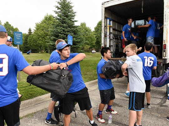 Members of the St. Cloud Apollo High School football team loaded duffle bags and suitcases into a truck Wednesday, July 20, 2016, for riders in the Bike MS: TRAM Ride 2016.
