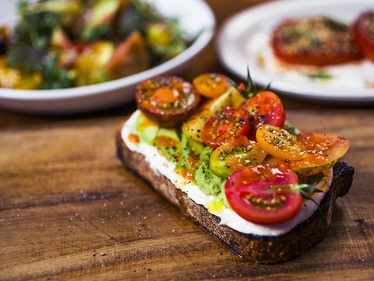 Tomato salad, broiled tomatoes with dukkah and sour cream, and tomato tartine with mascarpone at FnB.