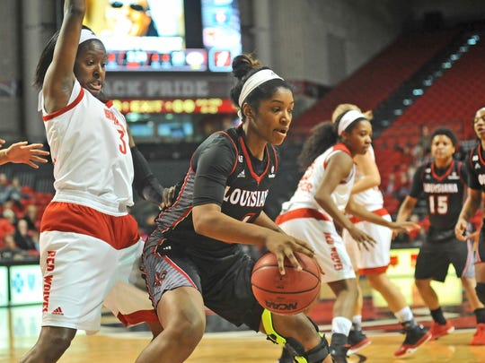 UL's Brooklyn Arceneaux, shown here battling in low post against Arkansas State, continues to adjust to a different role for the Ragin' Cajuns.