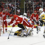 Red Wings lift their 'compete level,' ambush Penguins