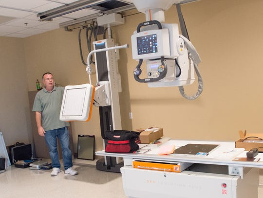 Jim Britt making final adustments to equipment installation
