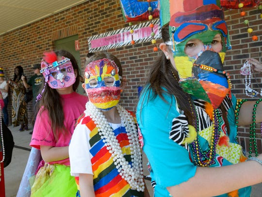 French Immersion students at Myrtle Place hold a Mardi Gras parade to raise money for a trip to Martinique. Friday, Feb. 24, 2017.