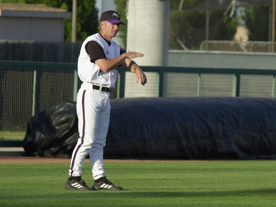 Britt Bonneau coaches from third base during his younger days with the Abilene Christian University baseball team. Bonneau resigned on Saturday, May 19, 2018 after 22 years as the Wildcats' head coach.