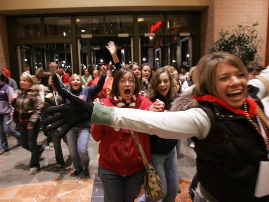 Thousands of shoppers stream into Jordan Creek Town Center moments after midnight on Black Friday.