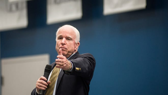Sen. John McCain speaks at a town-hall-style meeting at the Universal Training Institute's Avondale campus. McCain is a critic of the White House-backed Iran nuclear deal.