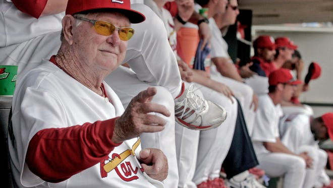 FILE - In this March 5, 2008, file photo, St. Louis Cardinals special assistant to the general manager Red Schoendienst sits in the team's dugout at Roger Dean Stadium during the Cardinals' spring training game in Jupiter, Fla., against the Washington Nationals. Schoendienst, the Hall of Fame second baseman who managed the Cardinals to two pennants and a World Series championship in the 1960s, died Wednesday, June 6, 2018. He was 95. The Cardinals announced Schoendienst's death before the top of the third inning during their game against the Miami Marlins. (AP Photo/James A. Finley)