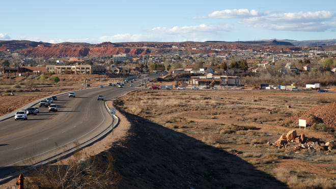 Traffic flows along River Road past empty land south of the Virgin River. A proposal to expand the roadway to five lanes as far south as Brigham Road moved forward last week at the St. George City Council meeting.