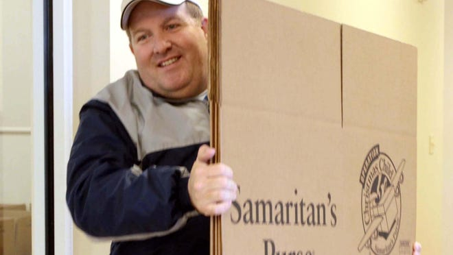 Darris Waren of Fair Park Baptist Church in West Monroe brings in a packing box for Samaritans Purse and Operation Christmas Child during last year's shoebox drive. This year's Operation Christmas Child continues at the church through Monday.