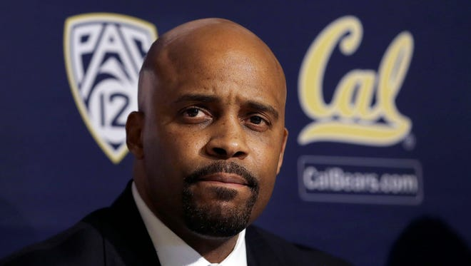 Cuonzo Martin sits at a news conference as he is introduced as the new men?s basketball coach at California in Berkeley, Calif., Tuesday, April 15, 2014. California hired Tennessee's Cuonzo Martin as its coach Tuesday, charging him with taking over another program after a successful run by his predecessor. Martin replaces Mike Montgomery, who retired last month after six seasons in Berkeley. (AP Photo/Jeff Chiu)