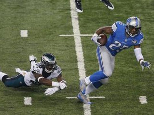 Detroit Lions running back Theo Riddick (25) pulls away from Philadelphia Eagles strong safety Walter Thurmond (26) during the first half of an NFL football game, Thursday, Nov. 26, 2015, in Detroit.
