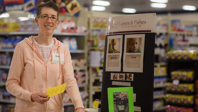 Appleton's Barb Ketter works to raise awareness and donations for Loaves and Fishes at the Pick 'n Save on Stoney Brook Road in Appleton. She has been a longtime volunteer with Loaves and Fishes.