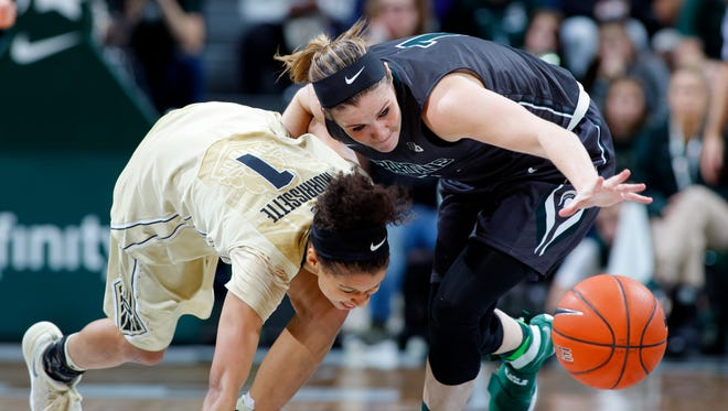 Michigan State's Tori Jankoska, right, steals the ball from Purdue's Ashley Morrissette Sunday, Jan. 22, 2017, in East Lansing, Mich. Michigan State fell 76-66.