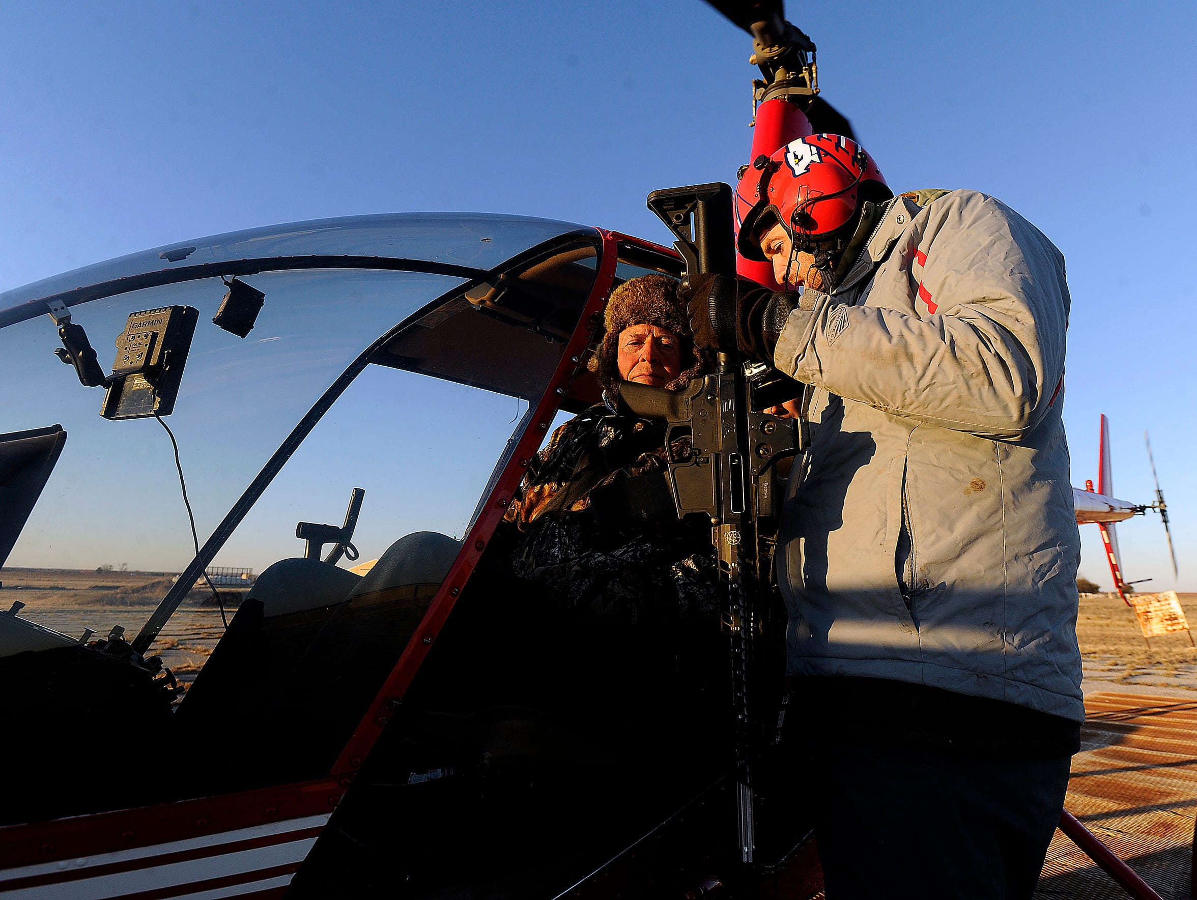 Cedar Ridge Aviation owner/pilot Dustin Johnson hands