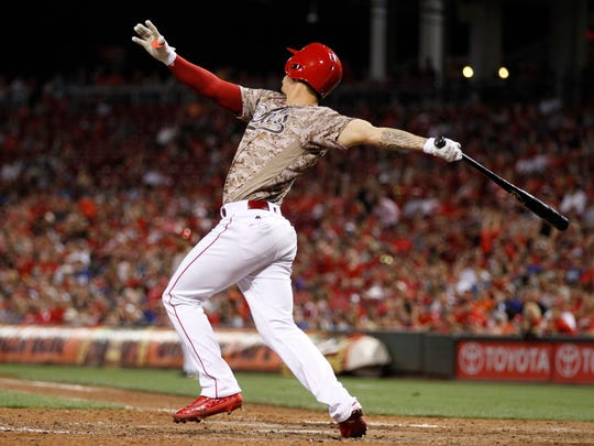 The Cincinnati Reds' Michael Lorenzen follows through on a three-run home run off Los Angeles Dodgers relief pitcher Pedro Baez during the seventh inning of a baseball game, Friday, Aug. 19, 2016, in Cincinnati. It was Lorenzen's first career home run.