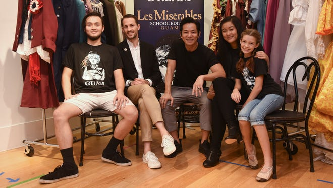 "Actors and creative members of ""Les Misérables School Edition Guam"" gather prior to rehearsing for Guam's latest stage production of the popular musical on Wednesday, Sept. 28, 2017. From left: Howard Smithers as Jean Valjean; Aviad Arik Herman, costume designer; Jojo Urquico, artistic director; Erica Tudera as Fantine and Lucy Barrera as young Cosette."