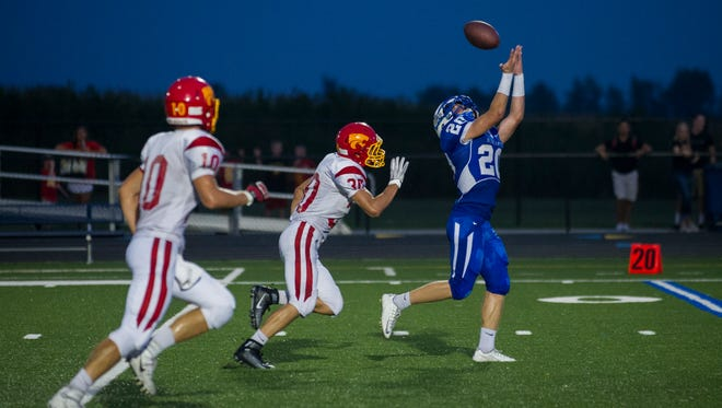 Bondurant-Farrar's Jarrid Clark reaches as high as he can to catch a ball just out of his reach. Carlisle and Bondurant-Farrar football teams battled to a 47-35 score resulting in a win for Carlsile.