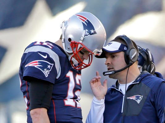 FILE - In this Dec. 4, 2016, file photo, New England Patriots quarterback Tom Brady (12) confers with offensive coordinator Josh McDaniels during the first half of an NFL football game against the Los Angeles Rams, in Foxborough, Mass. Patriots offensive coordinator Josh McDaniels says he's become a much better person and coach for having had a second stint with Tom Brady and Bill Belichick. (AP Photo/Elise Amendola, File)