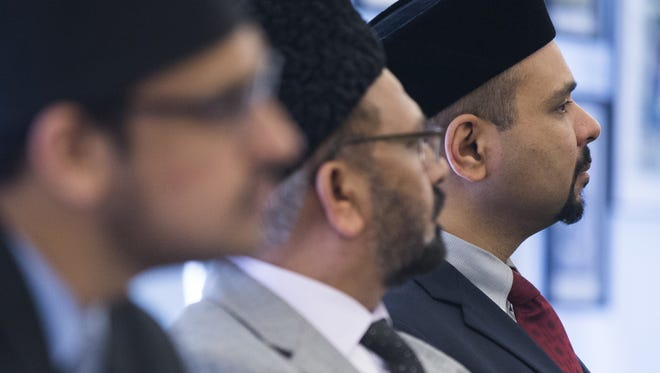 Shahzad Amjad (right) and other panel members listen during Ahmadiyya Muslim Youth Association's discussion of extremist groups at the Tempe History Museum in Tempe, AZ on Saturday, May 30, 2015.
