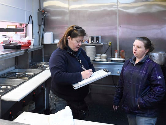 Food inspector Ivonne Rodriguez talks with Ruby's Kitchen