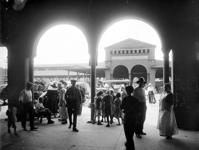 Merchants and patrons at Detroit's Eastern Market,