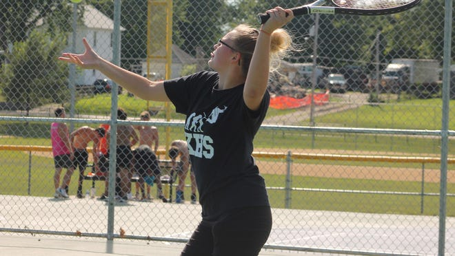 Kewanee High School's Kyra Shimmin works on her overhead service during a practice session on Wednesday at Northeast Park.
