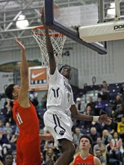 Ranney School's Bryan Antoine, shoots against Middletown North's Isaiah McDowell in the SCT quarterfinal at Toms River North High School Feb. 19, 2017. Photo by Vincent DiSalvio / Special to The ASBURY PARK PRESS