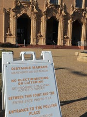 In this file photo, a distance marker is posted outside Memorial Auditorium stating that candidates cannot place political signs within a certain distance of the polling sites. The city announced they will begin Monday, Feb. 3, removing illegally placed signs within the city.