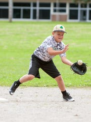 Brayden Bess fields the ball during 8U Shamrock practice