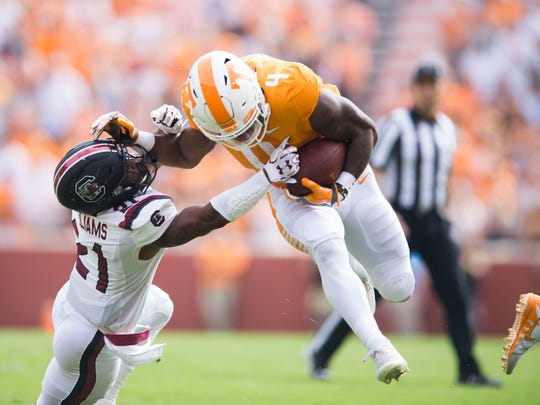 South Carolina defensive back Jamyest Williams (21) attempts to take Tennessee running back John Kelly (4) down during the first half of a Tennessee vs. South Carolina game at Neyland Stadium in Knoxville, Tenn. Saturday, Oct. 14, 2017.