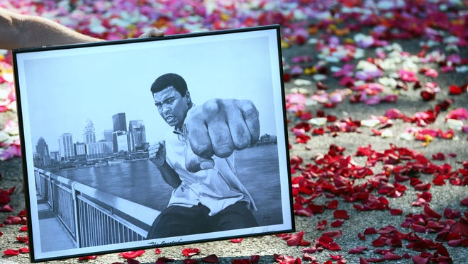 Nick Smith brought this piece of artwork to Cave Hill Cemetery to honor Ali. June 10, 2016