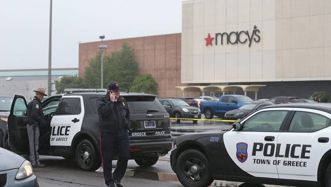 Greece  and State Police on the scene of a fatal officer involved shooting outside the Greece Ridge Mall in June 2015.