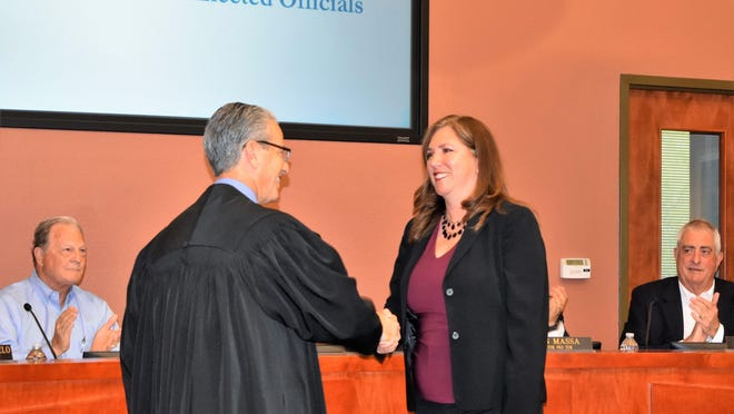Lakeway Mayor Sandy Cox is congratulated by Municipal Court Judge Kevin Madison following her swearing-in ceremony in May 2019. During Monday's meeting, the City Council approved ballot language that will allow local voters to decide in November whether they want to amend the term of office for council members and the mayor to two years.