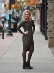 Gold sparkly dress, $56; black tights, $12; black booties,