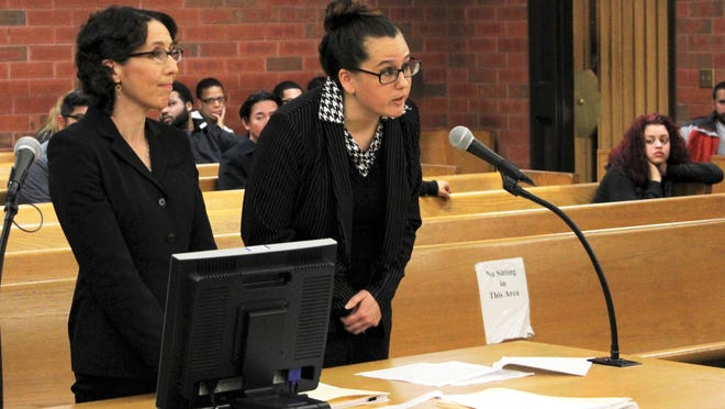 In this Tuesday, May 30, 2017 photo, University of Connecticut law professor Jessica Rubin, left, and UConn law student Taylor Hansen present arguments as animal advocates in a dog fighting case in Superior Court in Hartford, Conn. Connecticut last year became the first state to allow court-appointed advocates to represent animals in cruelty and abuse cases. (AP Photo/Pat Eaton-Robb)