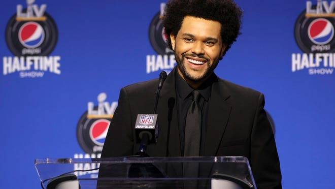 Recording artist The Weeknd speaks at the halftime show press conference ahead of the Super Bowl 55 football game, Thursday, Feb. 4, in Tampa, Fla.