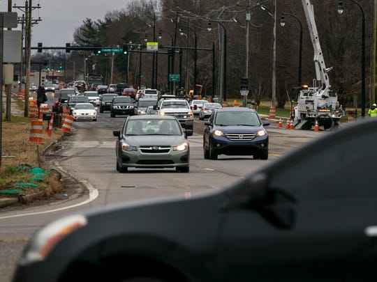 Cars approach the intersection of Hillsboro Road and Mack Hatcher in Franklin, Tenn., Wednesday, Dec. 21, 2017. The construction project of widening Mack Hatcher will allow the roadway to continue to Highway 96 by cutting into unused land.