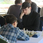 Cayge Holm, a member of the Athens Chess Club, considers his next move Saturday at the Great Lakes Chess Open.