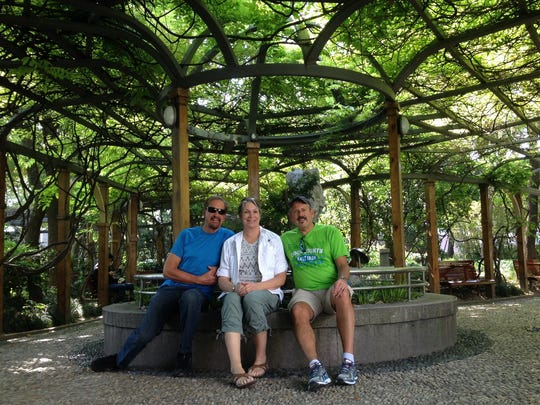 From left, Kevin Grohskopf, Mary Lopas and Phil Biebl enjoy the gardens in Shanghai on a sunny Sunday afternoon.