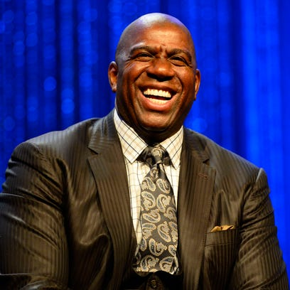 Magic Johnson laughs during the 2014 NBA All-Star Game