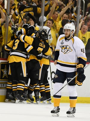 The Penguins celebrate the second goal as Nashville Predators left wing Pontus Aberg (46) skates in front during the first period of game 5 of the Stanley Cup Final at PPG Paints Arena Thursday, June 8, 2017, in Pittsburgh, Pa.