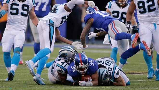 New York Giants' Odell Beckham (13) hits Carolina Panthers' Josh Norman (24) after teammate Shane Vereen (34) is tackled by Kurt Coleman (20) and Roman Harper (41) during the second half of an NFL football game Sunday, Dec. 20, 2015, in East Rutherford.