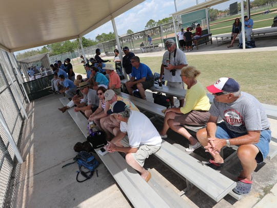 Fans enjoy the game as team members  who played in the other game sit with them. Minor league camp can beat big-league camp from a fan's perspective. You can get up close to future big league players and all the action. Many spectators become friends and get an inside scoop to the future team.