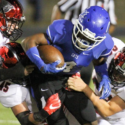 Meridian's Jaquaris Dean fights for yards as he's wrapped