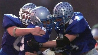 Manasquan running back Tyquan Walker (center) celebrates with teammates after scoring in the 1999 NJSIAA Central Jersey Group II final against Somerville.