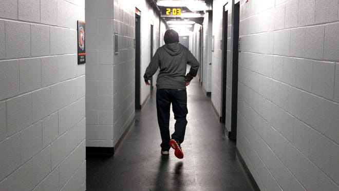 Joe Vicario, RIT hockey's student manager makes his way to the ice before practice.