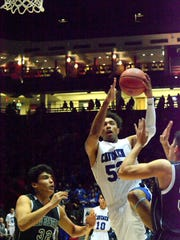 Carlsbad junior forward Chris Johnson attacks the basket
